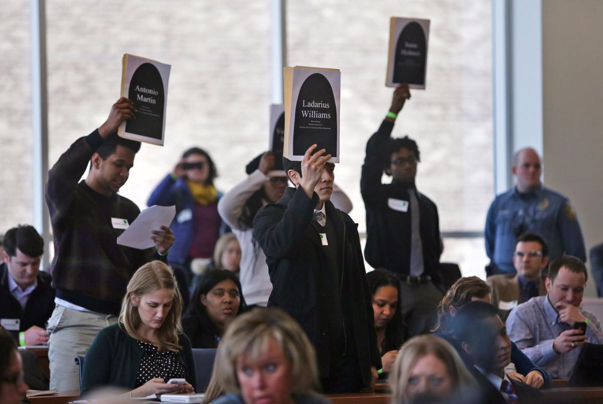 Police remove protesters who interrupt McCulloch at SLU law school symposium
