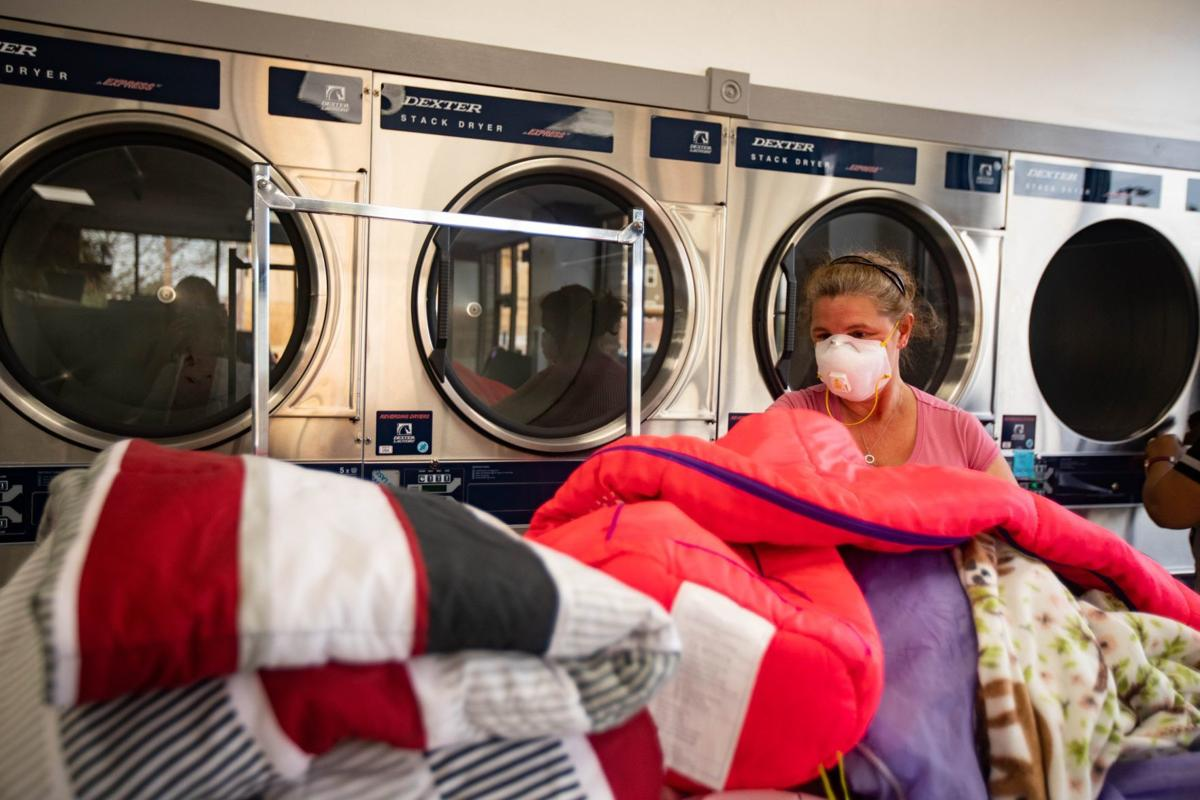 People stay safe while doing laundry in University City