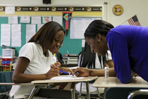 Eboni Boykin talks over an assignment with a classmate