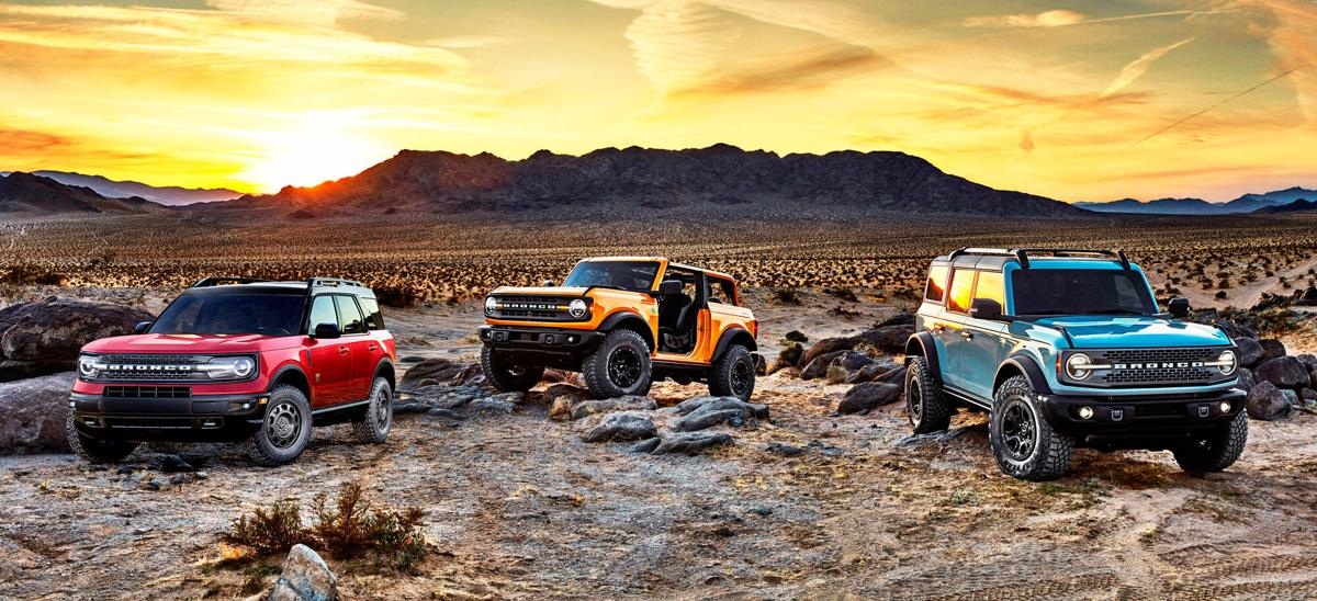 Versions of the all-new, 2021 Ford Bronco include, from left, the car-based Bronco Sport and the truck-based two-door Bronco and four-door Bronco.