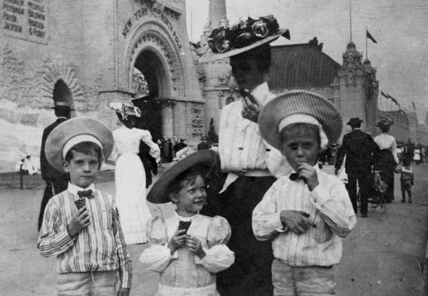 Woman and children eat ice cream at the 1904 World's Fair