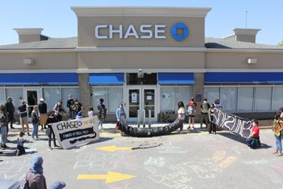 St. Louis activists stand outside of Chase Bank in Brentwood