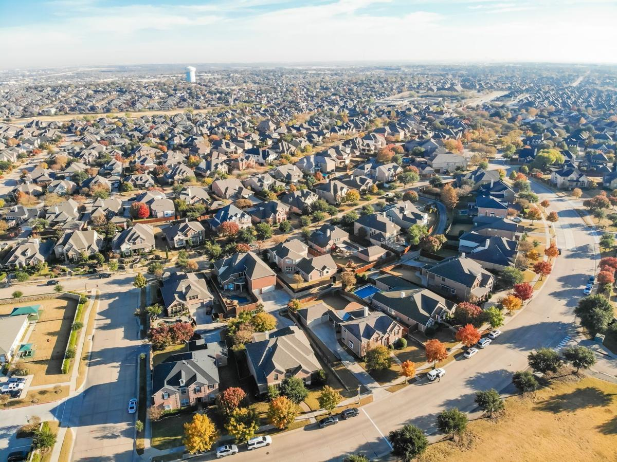 Top view row of single family houses in residential area with fall foliage