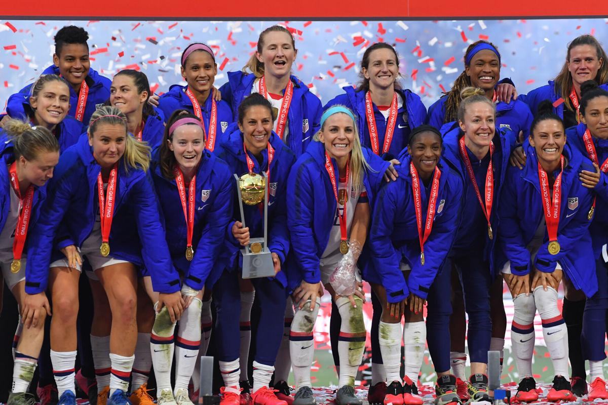 Carli Lloyd, middle, and fellow United States teammates celebrate after defeating Canada, 3-0, in the CONCACAF Women's Olympic Qualifying Final at Dignity Health Sports Park on February 9, 2020, in Carson, California.