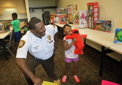 St. Louis County Police give toys to children of mother killed in car jacking