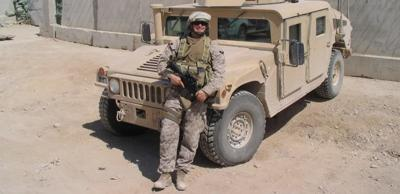 Veteran seriously injured in Iraq continues to serve at home
