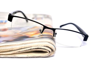 newspaper reading glasses
