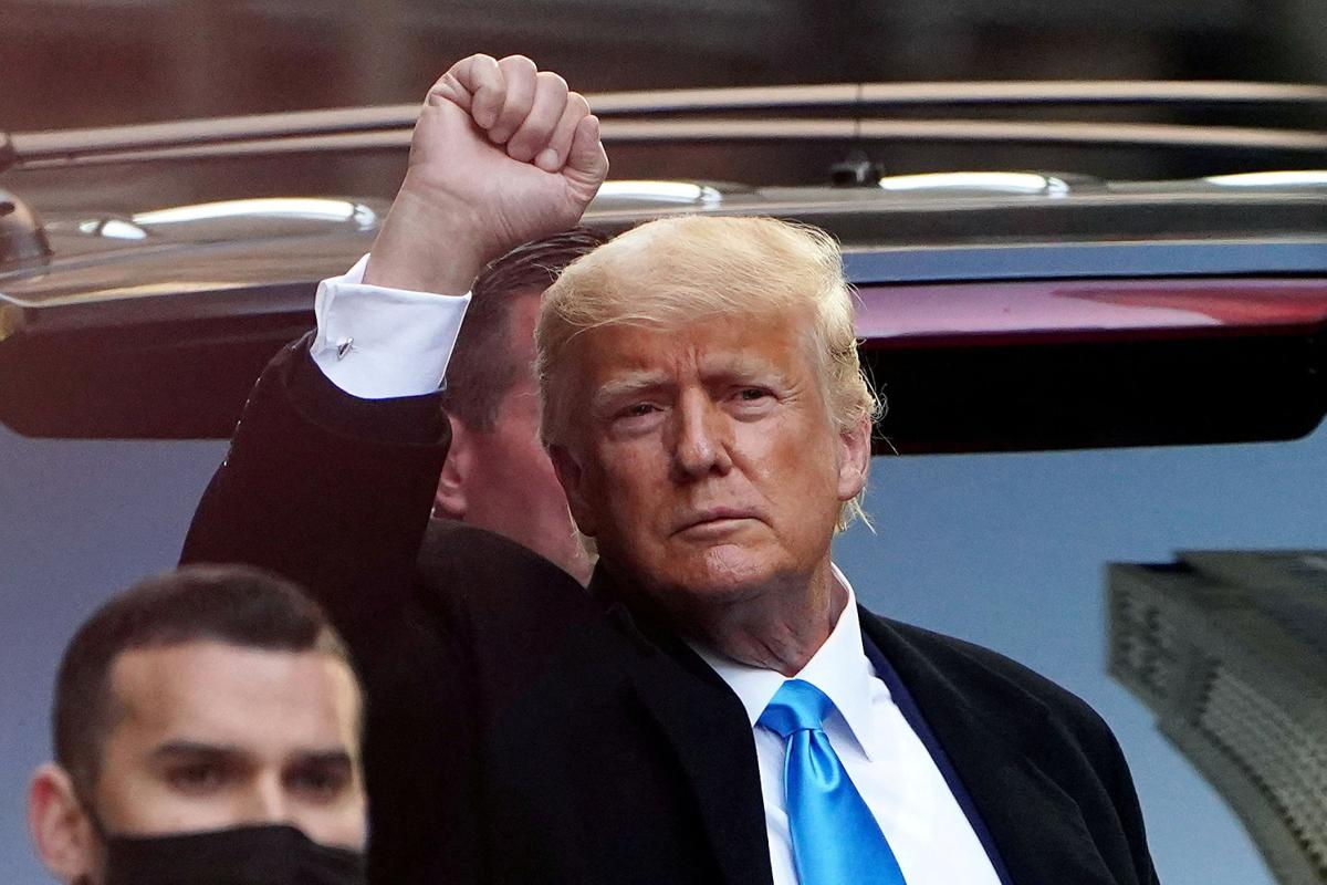 FILE PHOTO: Trump acknowledges people as he gets in his SUV outside Trump Tower in New York City
