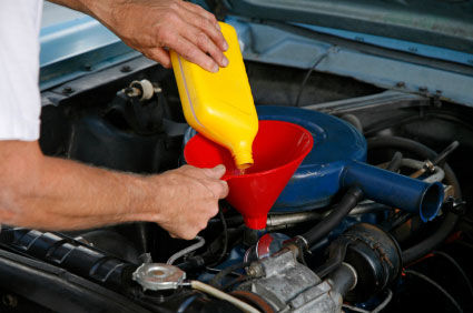 Image result for oil change technician
