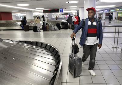 Methodists arrive at St. Louis Lambert International Airport