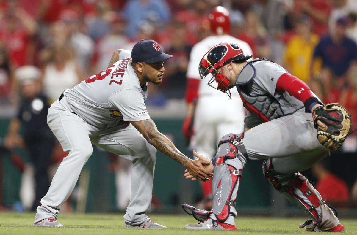 Photos: Down 7-0, Cardinals rally for 10 in the 6th and hold on for win