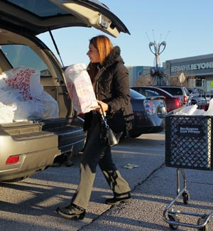 Shopper loads her car at St. Louis Mills in Hazelwood