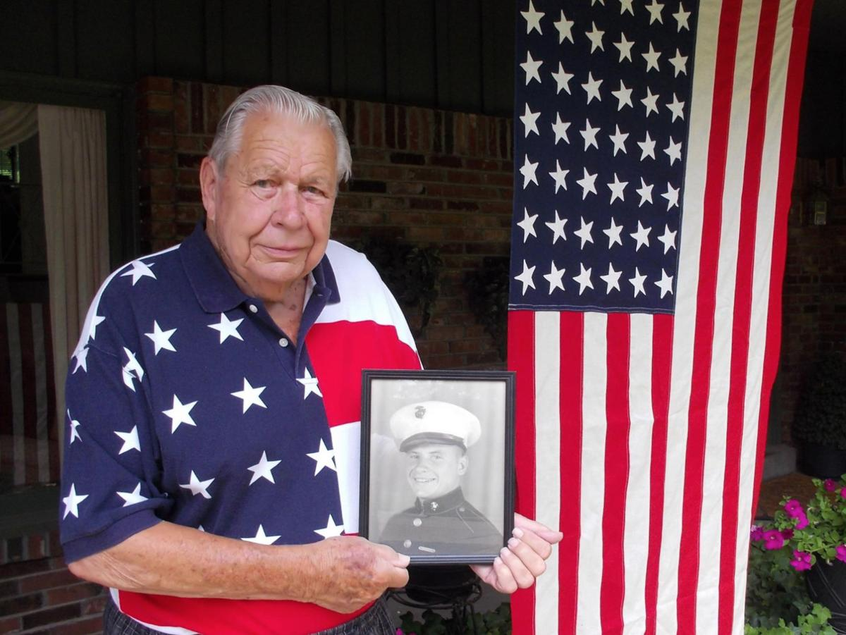MAIN PHOTO Charles Kohler at home in Warson Woods, holding picture of brother Eddie