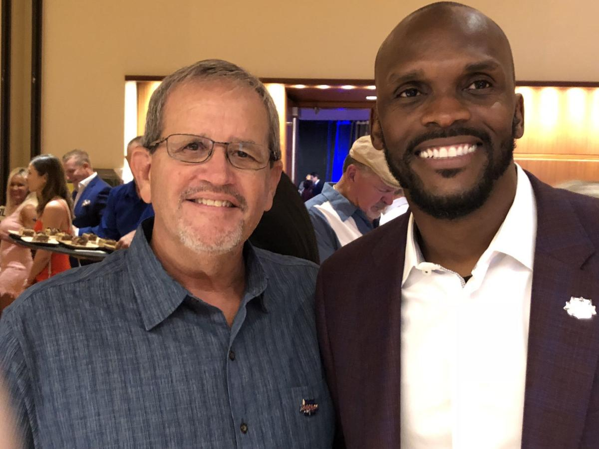 Isaac Bruce and Jim Anderson