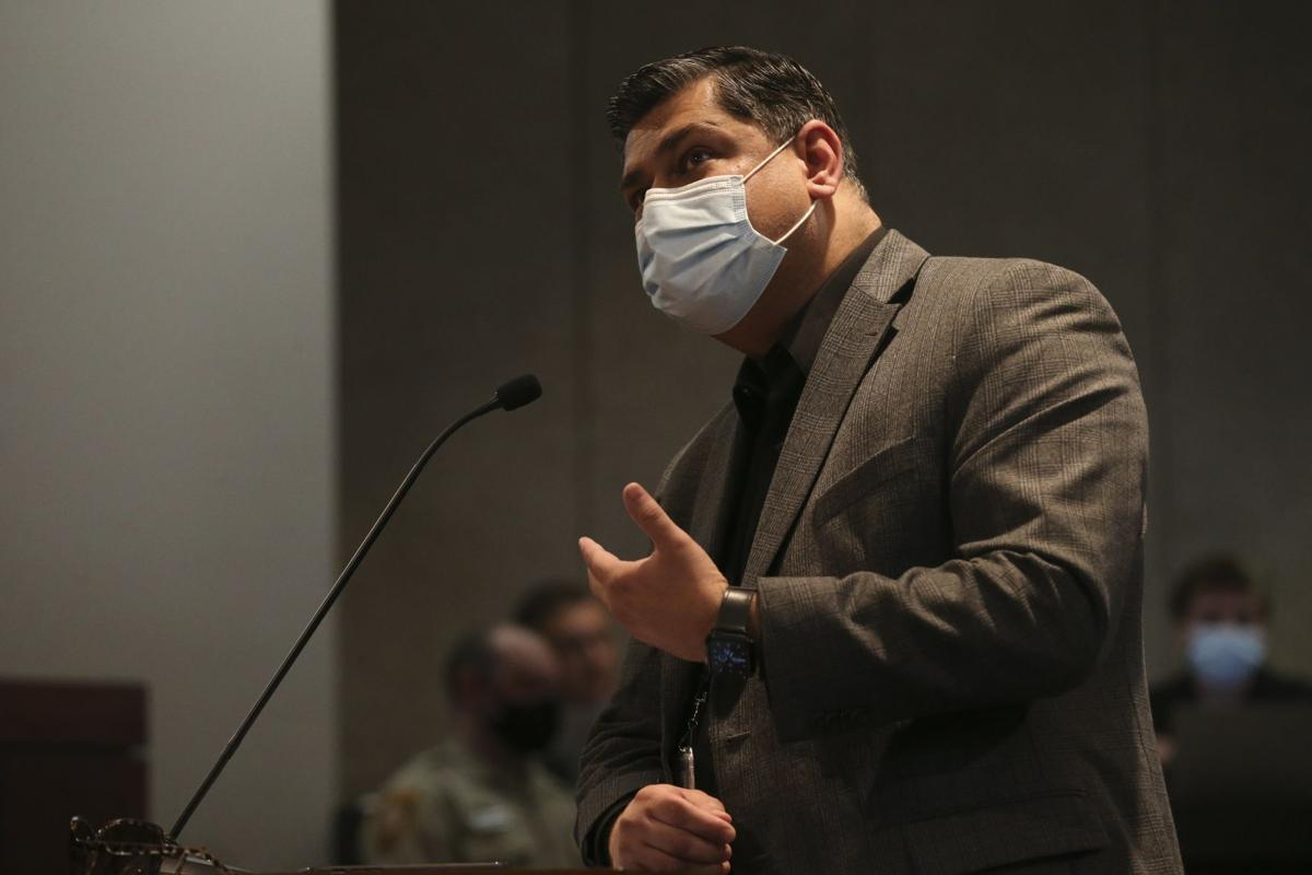 Dr. Faisal Khan, the director of the Department of Public Health, answers questions