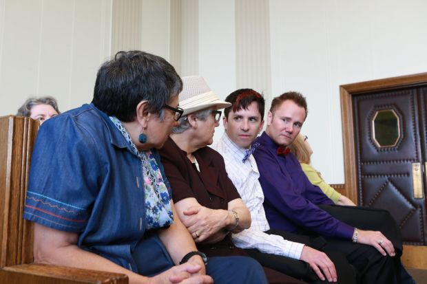 Same-sex couples attend hearing in class action case