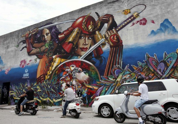 Visitors On Vespas Take Graffiti Art Tour In Miami
