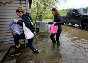 Mother's Day in a flooded home: Missouri family makes do as floodwaters begin to recede