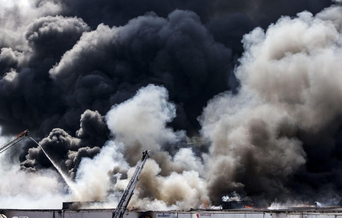 Large fire rolls through warehouse