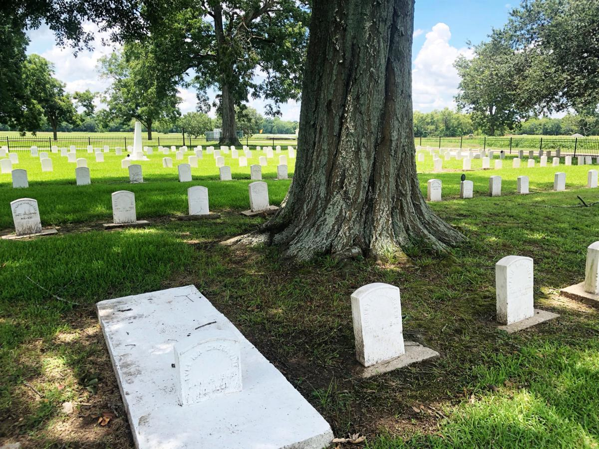 Markes for former leprosy patients line a graveyard in the former leprosy colony at what is now the Gillis W. Long National Guard Center in Carville