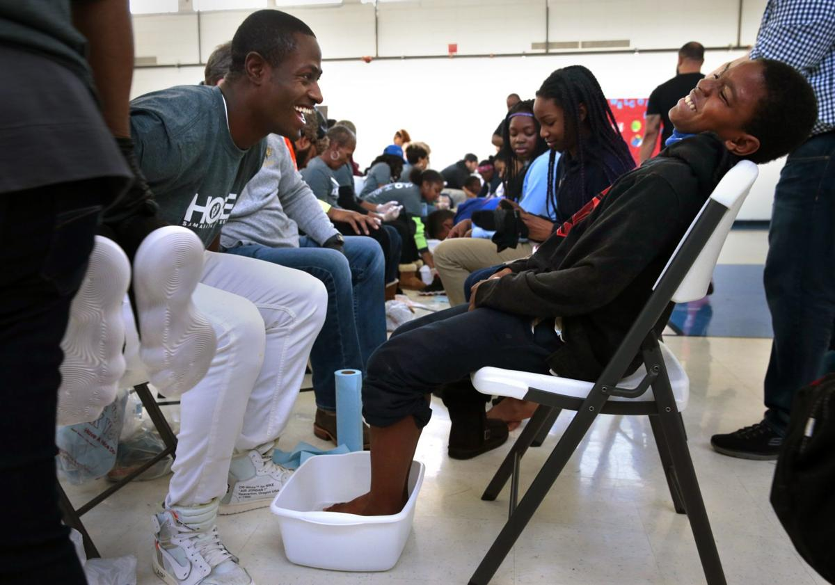 NFL's Desir gives back to St. Louis, one pair of shoes at a time