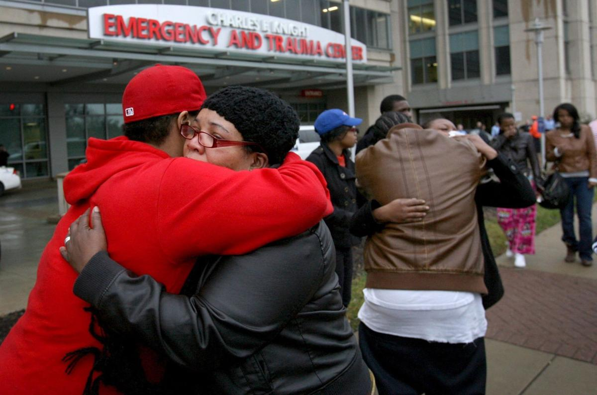 Family of man shot by police mourn outside hospital