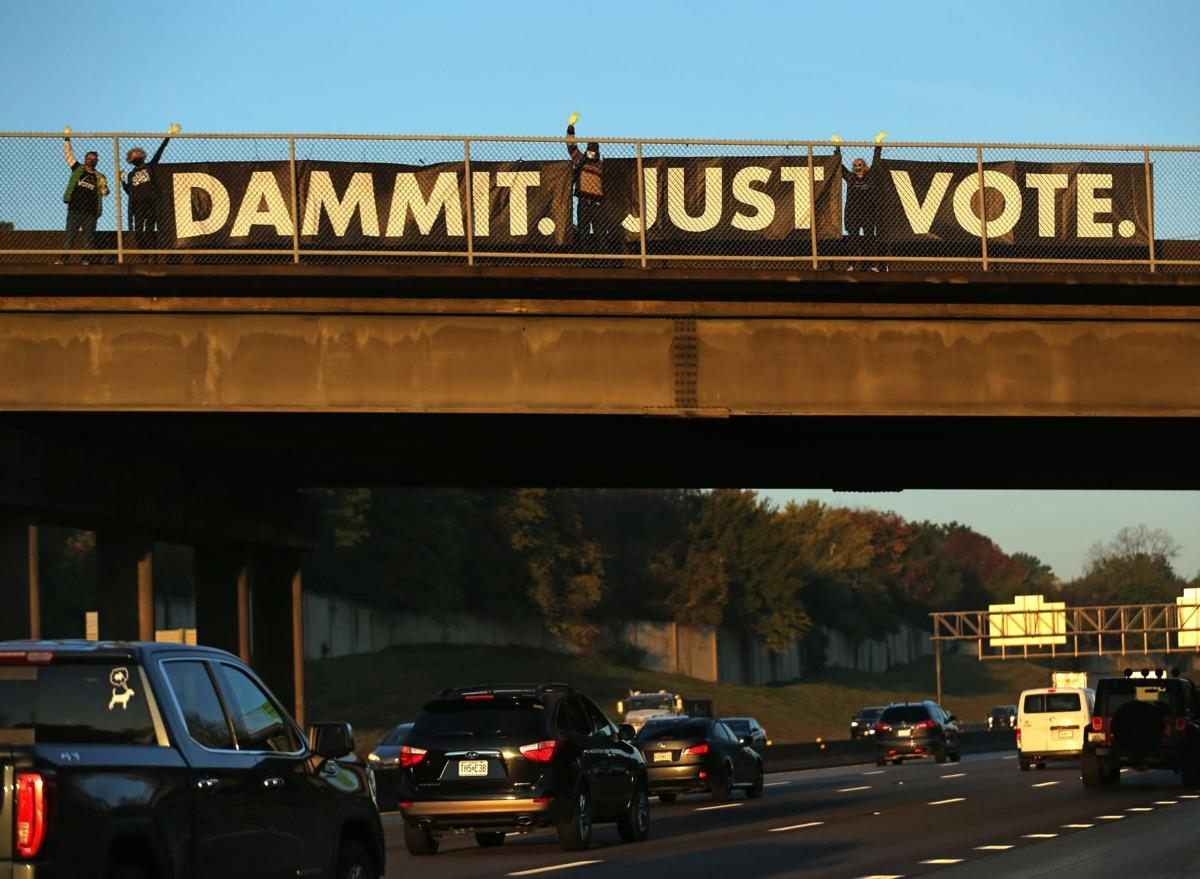 """Dammit. Just Vote."" banner hung on Sappington Road overpass at I-270"