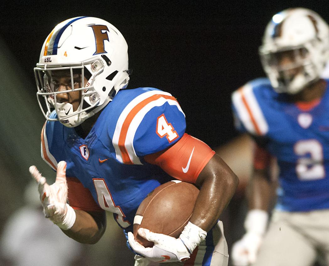 East St  Louis survives Trinity in triple overtime classic