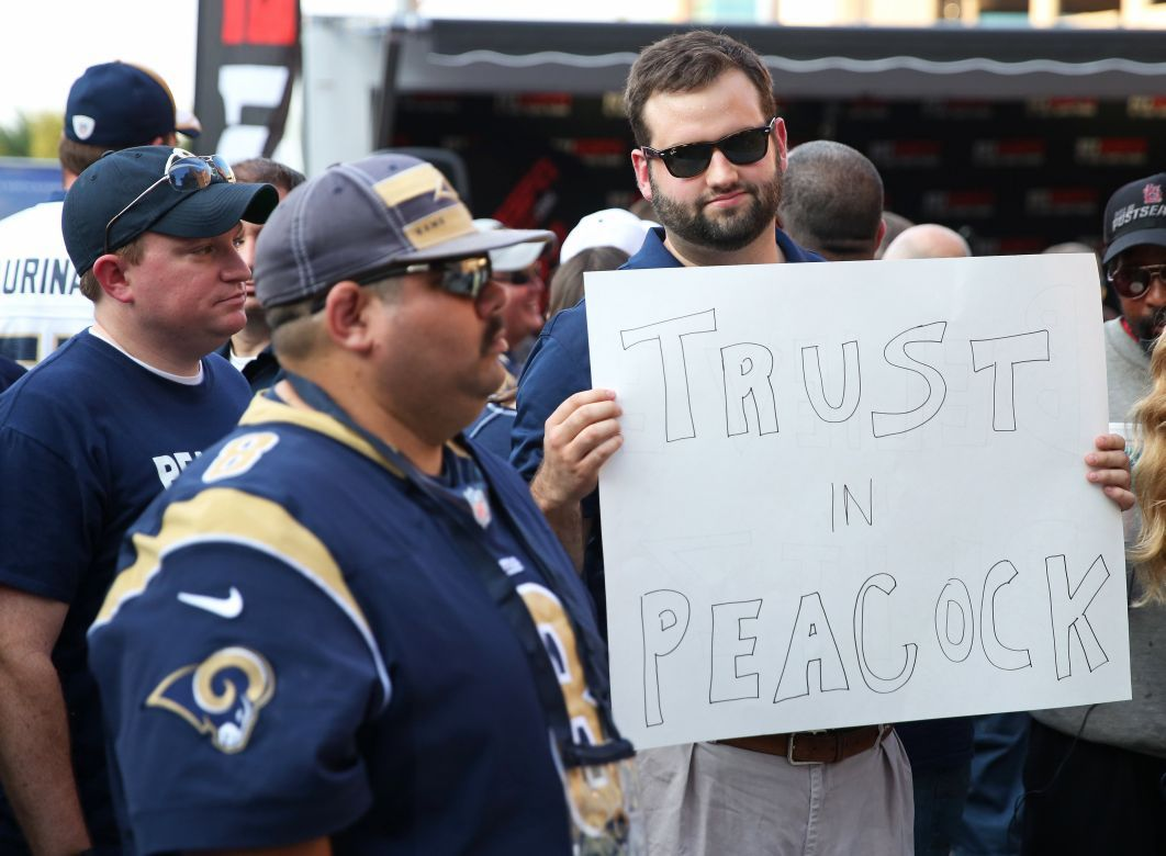 Rams fan holds sign that says 'Trust in Peacock'