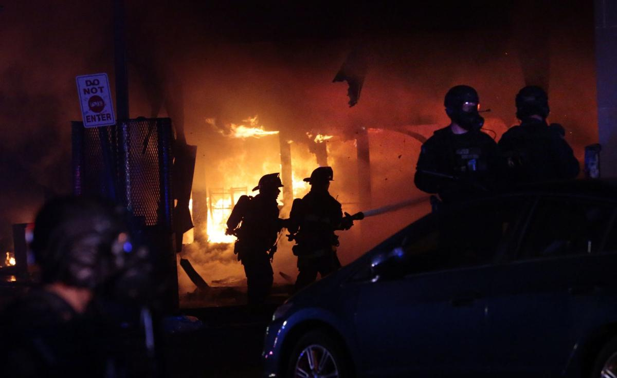 Vandals set fire to downtown 7-Eleven following protest at police station