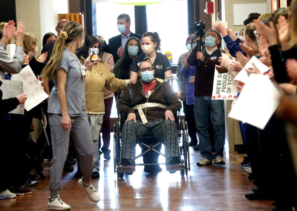 Staff cheers as COVID-19 survivor Joshua Miller discharged from St. Luke's Hospital