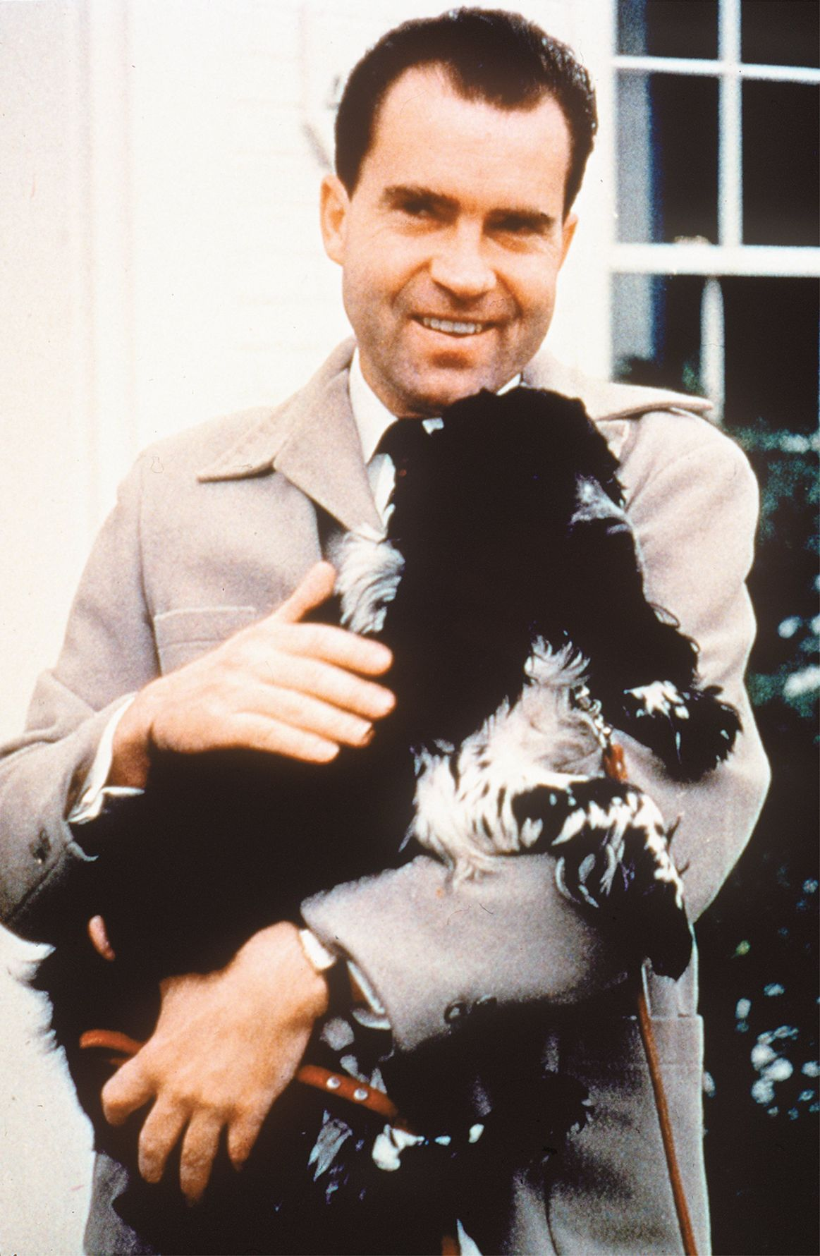 Richard Nixon with Checkers, his cocker spaniel, on July 2, 1959.