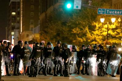 St. Louis police officers after kettling at Washington Avenue and Tucker Boulevard in St. Louis