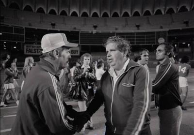 SIUE coach greeting SLU coach