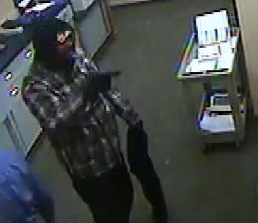 Authorities searching for two suspects in the robbery of a PNC Bank