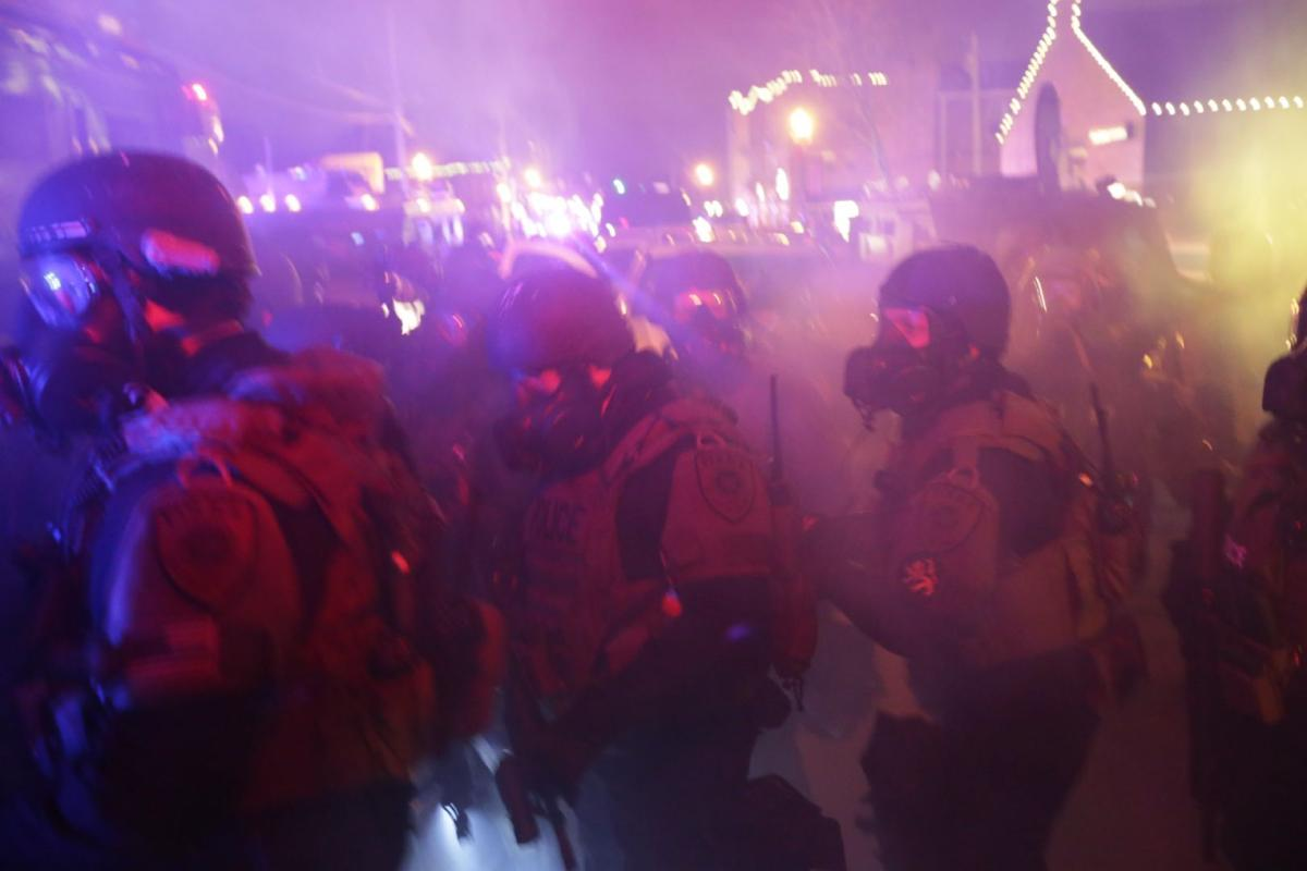 St. Louis County Police respond to crowds after grand jury announcement