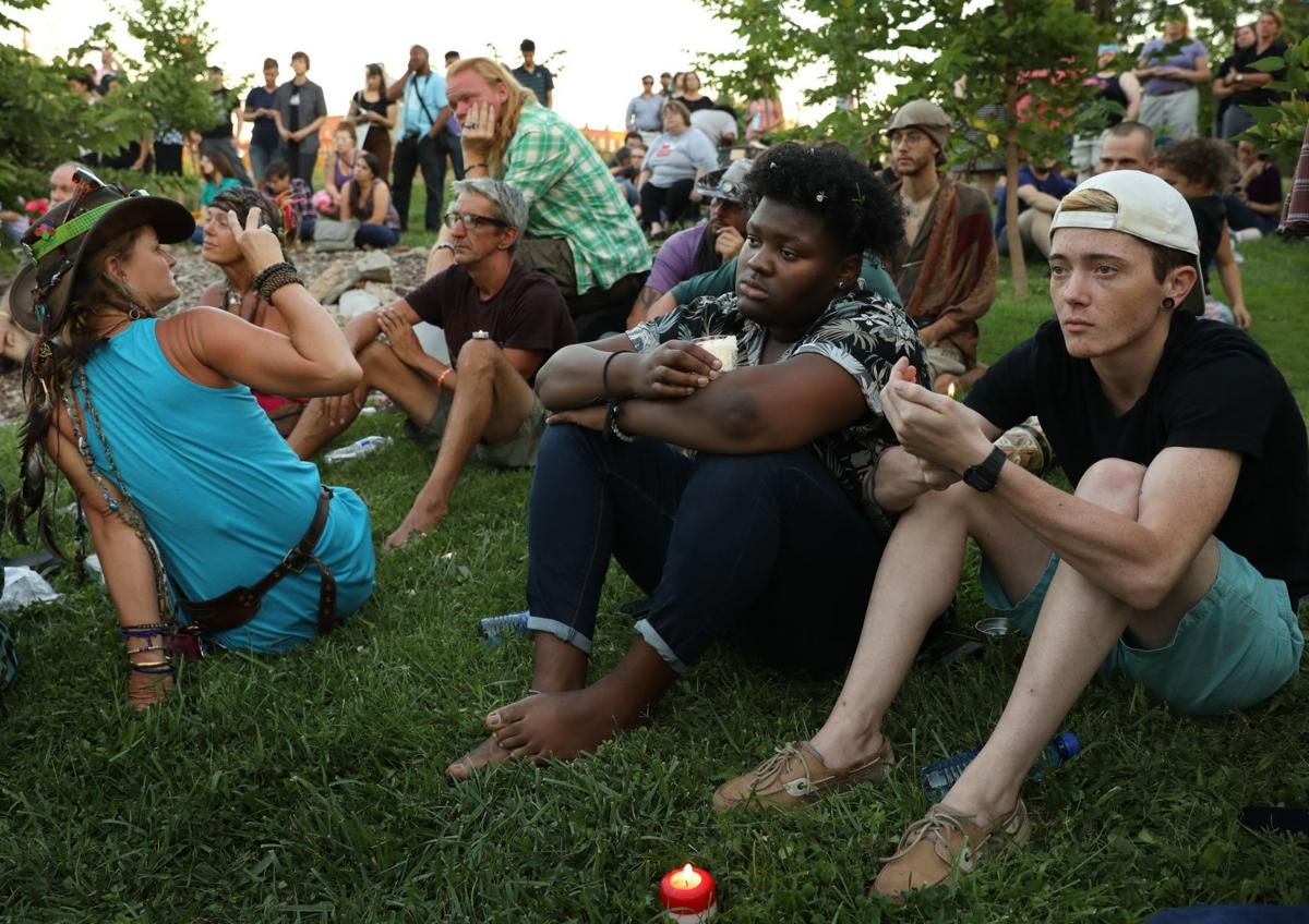 Protesters hold candlelight vigil