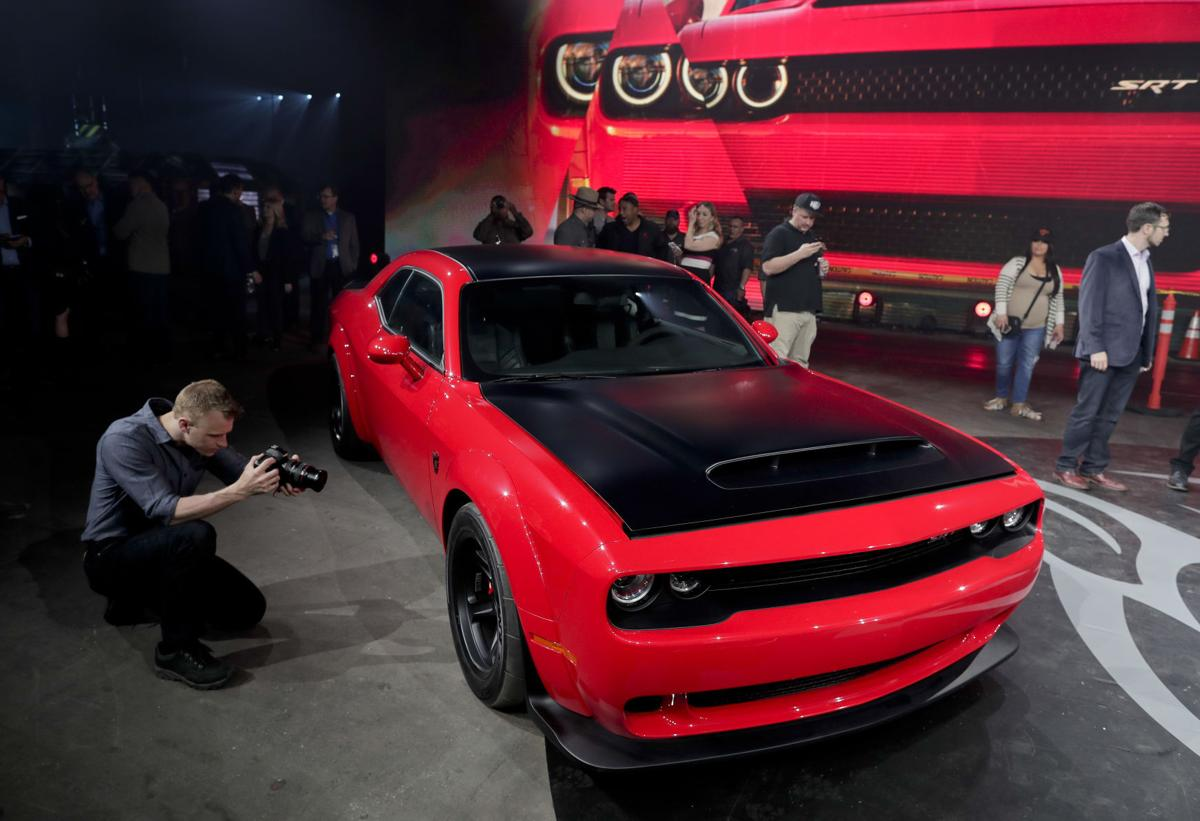 The 2018 dodge challenger srt demon sits on display during a media preview for the new york international auto show tuesday april 11 2017 in new york