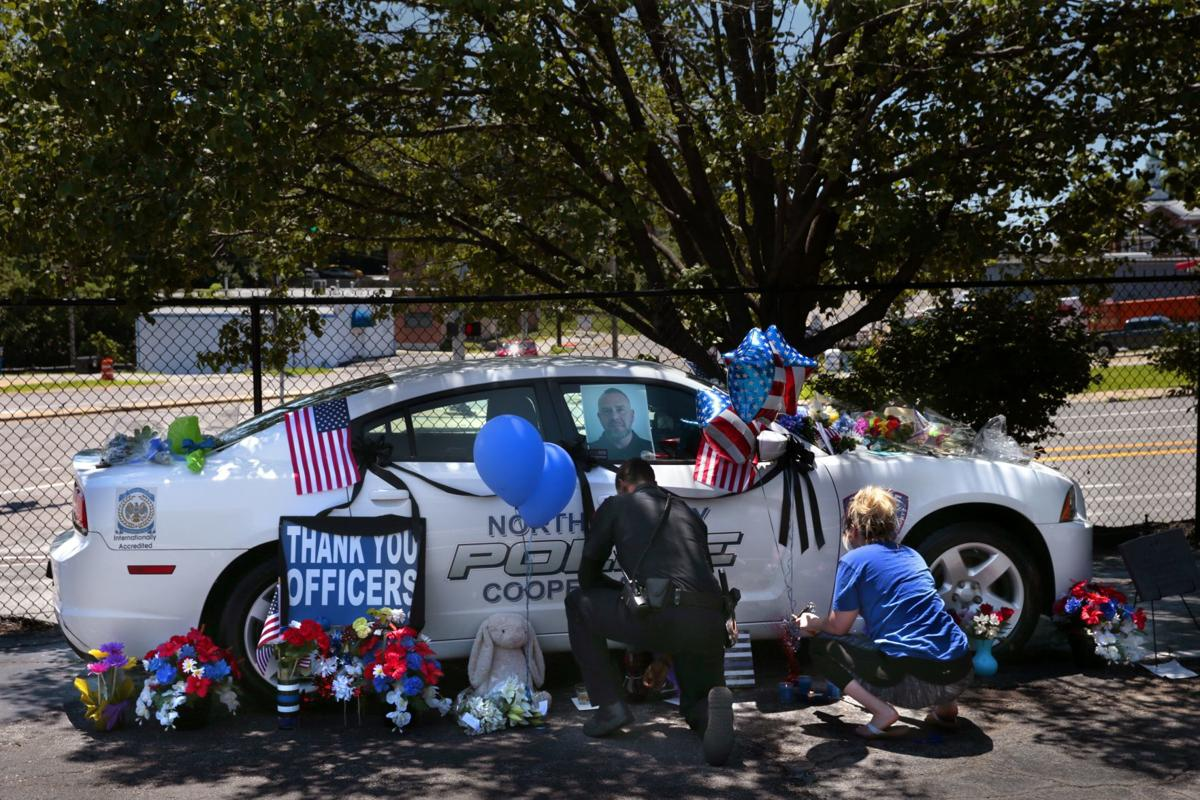 Memorial to fallen officer grows