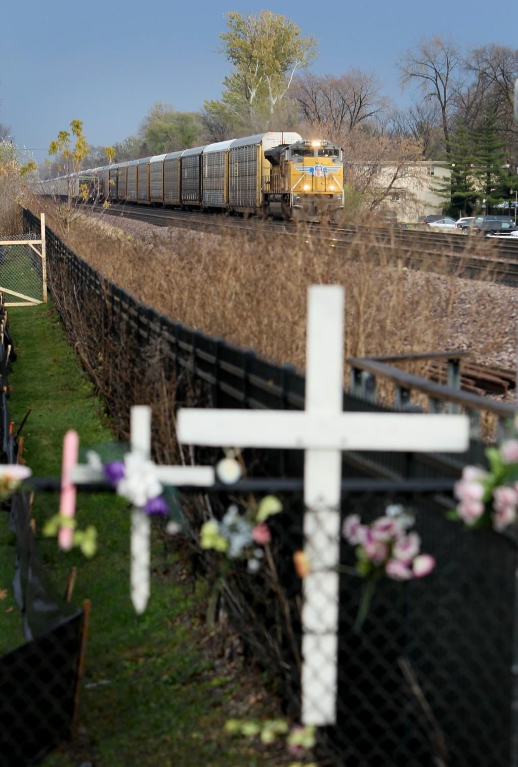 Towns, train fight over fences -- and responsibility for