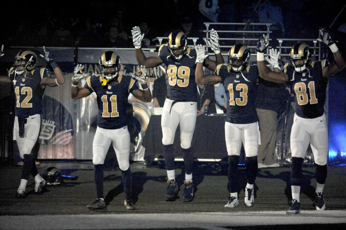 Rams players show 'hands up'