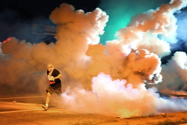 Judge orders St. Louis area police to give protesters tear gas warning and time to flee