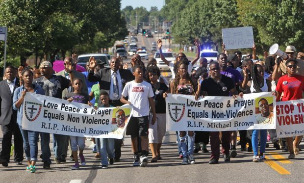 Ministers try peaceful protest through Ferguson