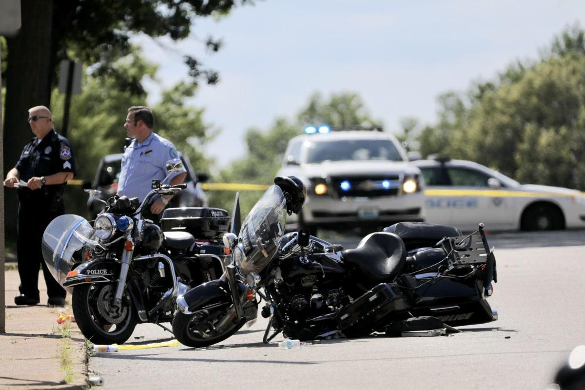 Two police officers injured in St. Louis crash during motorcade escorting slain officer