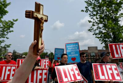 Anti-abortion and abortion rights activists protest in St. Louis