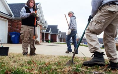 Response Team Member Supervises As Anna Bettger Left And Jeremiah Chamberlin Plant A Tree In Front Of Newly Rebuilt Home Joplin Mo On Dec
