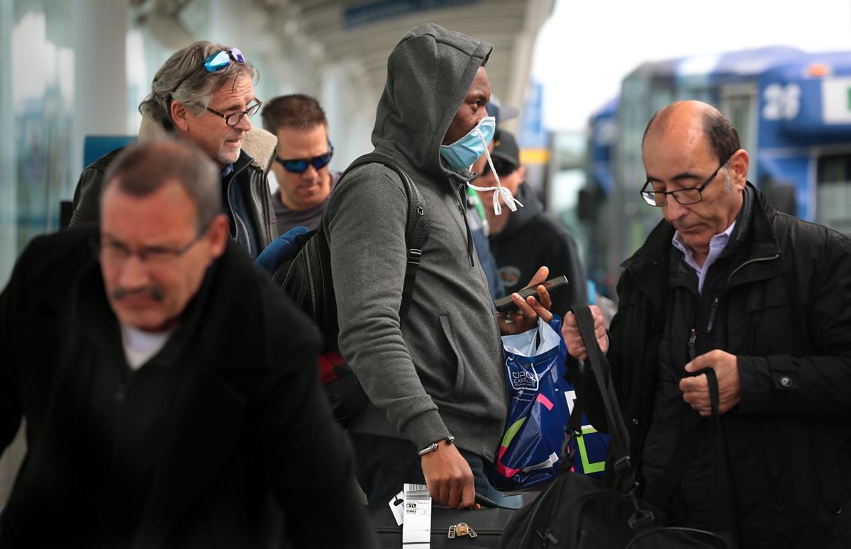 Few travelers arriving in St. Louis taking precautions against the coronavirus