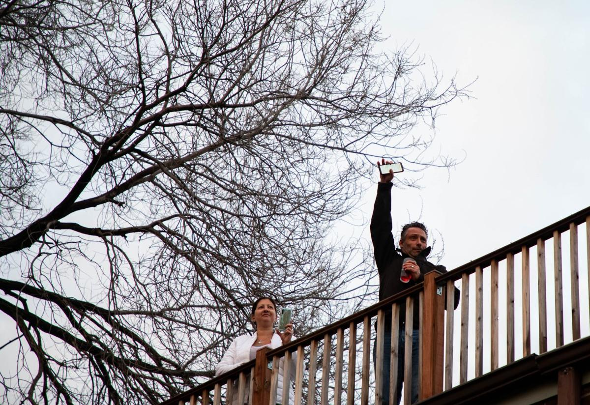 Man brings neighbor together in the wake of socical distancing to sing a song from his balcony every night