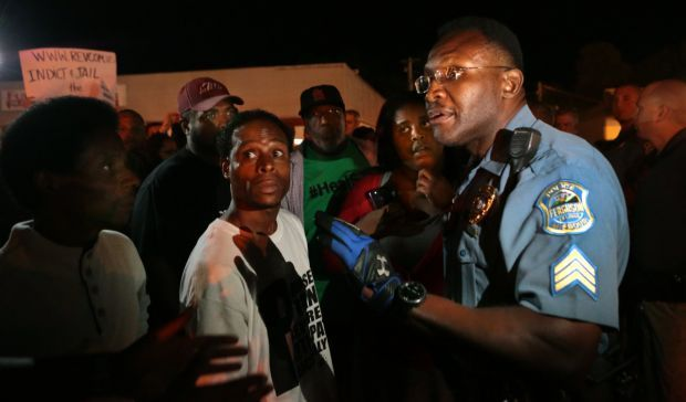Officers look for calm after Ferguson looting