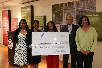 The Credit Union presents a check to the Urban League of Metropolitan St. Louis